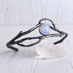 Created as a reminder of the magic and power of moonlight on a dark and stormy night... These sterling silver vines encircle a flashing blue and green labradorite cabochon, each is especially chosen f