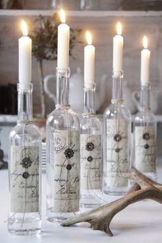 adding scrapbook paper to wine bottles and using them as interesting candle holders for an event. I think I would do something like a message in a bottle :) Bottle Candles, Bottles And Jars, Glass Bottles, Wax Candles, White Candles, Scented Candles, Decoration Shabby, Decoration Table, Non Floral Centerpieces