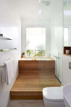 cover a usual soaking tub with wood and the shower space also to achieve that Japanese inspired look