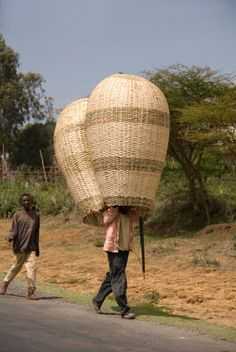 Africa | Man carrying large baskets for sale at the market.  Southern Ethiopia | ©John Elk / Lonely Planet