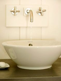 {wall-mount faucet tips} 1) be sure the design works for your sink; 2) follow manufacturer's specs for the correct height and placement to minimize splashing; 3) for a deep vessel sink, it's typically suggested that the water stream be positioned to hit just behind the sink drain. | better homes and gardens