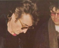 John Lennon, signing autograph before his death, the fan for whom he is signing is Mark David Chapman, who would come back to shoot him a few hours later.