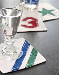 Fabric Coasters.. Coasters made of recycled sails are designed to be waterproof, $20 for a set of fou
