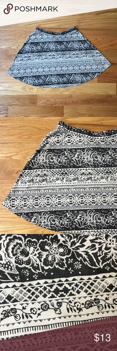 "LA Hearts black & white skater skirt About: • brand: LA Hearts  • size: medium  • floral pattern on black and white  • skater skirt  Measurements: • waist: 24"" elastic waistband  • length: 16"" LA Hearts Skirts Circle & Skater"