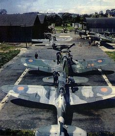 This has to be a rare photo of several British aircraft... Spitfire Corsair Martlet (Wildcat) and Barracuda and Hurricane (far end).