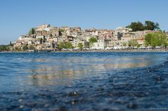Anguillara Sabazia is a town and comune in the Metropolitan City of Rome, Lazio, central Italy, around 30 kilometres (19 mi) northwest of Rome. It nestles on a small cape on the coast of Lake Bracciano.