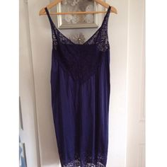 """Vintage Navy Lace Plus Size Full Slip This slip is beautiful. Hard to find vintage plus size. Pinup style. Adjustable straps. Lace panel in front for large fuller bust size. Small slit in back for your pinup skirts. Or wear this under a top or sweater for a sexy night time look. Or as a Hollywood glam nightgown. 42-44"""" bust unstretched. 40"""" waist underarm to hem 31"""". Beautiful vintage condition. Fits 1X- smaller 2X Vanity Fair Intimates & Sleepwear Chemises & Slips"""