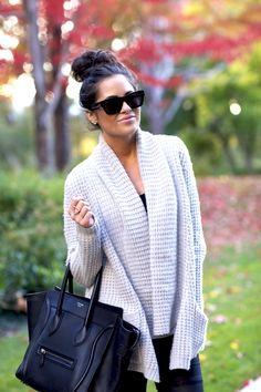 chunky sweater, top knot, and black pants