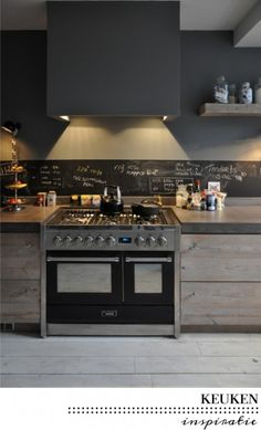 rustic contemporary kitchen - gray walls - limed slab cabinets -  fornuis