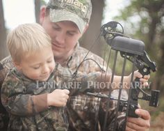 A man in camo and a little blonde boy=perfect