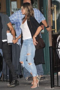 Jennifer Aniston in a low-key jeans and white tee combo while enjoying a dinner date with boo Justin Theroux in New York, July 2017