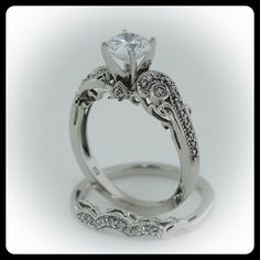 Moissanite Wedding Set $1880.00  Normally, I don't like this art deco look, but it's actually quite pretty here.