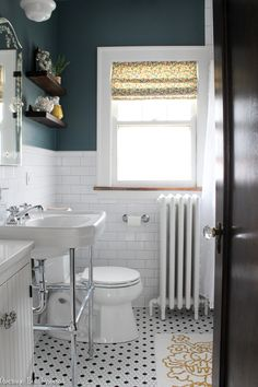 Home Renovation Bathroom This bathroom renovation is gorgeous! White subway tile, a console sink with chrome legs, the original 1927 mirrored medicine cabinet and more make it feel original to the home. Bathroom Design Small, Bathroom Interior Design, Bathroom Styling, Bathroom Designs, Shower Designs, Bathroom Renovations, Home Renovation, Home Remodeling, Architecture Renovation