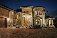 Tuscan Inspired Horseshoe Bay Lakeside Home, Front Elevation by Zbranek & Holt Custom Homes, Horseshoe Bay Luxury Home Builder