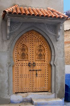 Africa | A rather new studded door and portico in Chefchaouen, capital of the Rif Mountains © Daniel Nadler