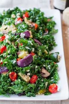 An awesome kale salad for year round, but ESPECIALLY for a chilly winter-to-spring transition! Big chunks of warm, oven roasted veggies, simply dressed balsamic kale, and a healthy handful of creamy parmesan.