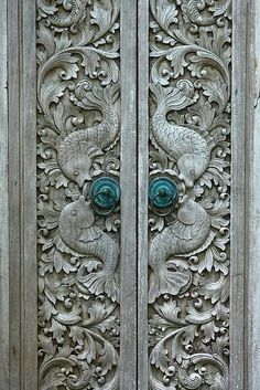 Doors with Carved Fish Design | via Princess Fingers Glued Togther.tumblr.com