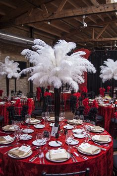 Feather Centerpiece Ideas.  Pinned by Afloral.com from http://loftonlake.com/a-1920s-speak-easy-corporate-dinner ~Afloral.com has high-quality ostrich feathers, crystals and vases for your glam event.