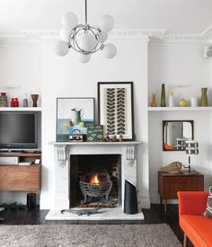 "Light My Fire ""I didn't want to compromise the Victorian nature of the house,"" she says. Although the original fireplace was in good shap..."