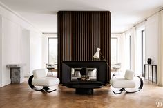 Joseph Dirand: Designer to the Stars / For clients in Germany, architect Joseph Dirand created a fluted marble chimneypiece. / Adrien Dirand