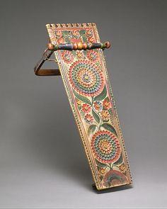 Cradle Board -- Circa 1860 -- Quebec -- Mohawk Culture -- Wood, rawhide & pigment -- The Metropolitan Museum of Art