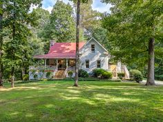 This charming home in Tennessee - love the porch.....