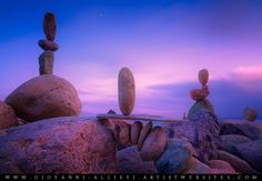 Balanced rocks on a beach at dusk with a zen feeling. Prints available at http://giovanni-allievi.artistwebsites.com/art/all/intimate+landscapes/all