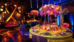 Empty Vase- Rich jewel toned floral centerpieces ranging from vibrant burnt orange and gold, yellow fuchsia to blues and purples | Wedding | Sonia Sharma Events, Andrena Photography, Revelry Event Designers, Images by Lighting, Classic Party Rentals