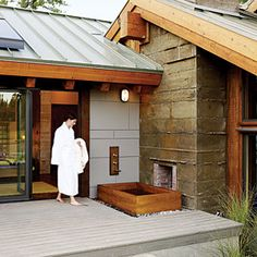 A Japanese ofuro (soaking tub) turns a deck into a personal spa outside the master bedroom.