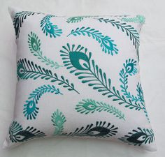 white and blue peacock feather throw pillow by Comfyheavenpillows, $34.99