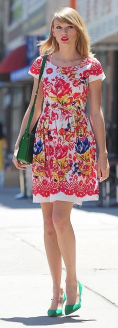 Taylor Swift street style: The perfect floaty floral dress made for a colorful statement when paired with emerald heels and a matching purse.