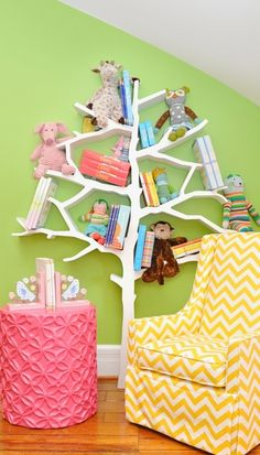 Loving this, lemon chevron, chartreuse/apple walls, punchy pink ottoman, and a fantastic bookshelf tree. Okay I need a new nursery client so we can do that bookshelf in the install!!!!