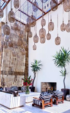 Beautiful living space in Architectural Digest - woven pendants  natural light