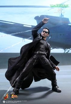 An authentic and detailed likeness of Keanu Reeves as Neo in The Matrix. The Matrix. Keanu Reeves, Keanu Charles Reeves, Keanu Matrix, I Movie, Movie Stars, The Matrix Movie, Sideshow Collectibles, Black And White Colour, Movie Characters