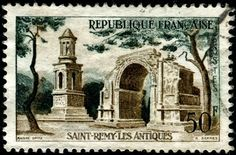 Ruins of the Roman city of Glanum, including the Mausoleum of the Julii (c. 40 B.C), and the triumphal arch (10-25 B.C.), located in the outskirts of Saint Remy de Provence. Stamp issued by France, circa 1957