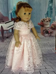 A really pretty pink dress. I used a pink lace with a scalloped edge for this dress. It is lined with pink satin. The sundress has a bias drape with a pink rose attached. It has velcro closing. All seams have been professionally finished. Made in my smoke free home.
