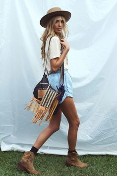 Fringed satchel, cowboy boots, hat, add a touch a sparkle:relaxed festival ready flair