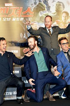Mark Ruffalo, Chris Evans, Robert Downey Jr and Joss Whedon pose for a photo session during a press conference to promote Marvel's 'Avengers: Age Of Ultron' in Seoul on April 17, 2015