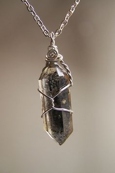 Tibetan Quartz Double Terminated crystal necklace by CoyoteRainbow
