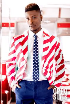 Add some stars and stripes to your wardrobe and claim the spotlight on the of July, during campaign rallies, or at the Olympics. This American flag suit from OppoSuits will make sure you'll be the highlight of the show. God bless the United Stripes of Marvel Wedding Theme, Comic Wedding, Geek Wedding, Wedding Suits, American Flag Suit, American Pride, Ugly Sweater, Ugly Christmas Sweater, Blue Tux