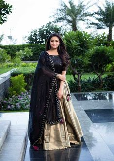 Indian actress Keerthy Suresh wears a stunning black and gold lehenga for the promotions of her upcoming tamil movie Sandaikozhi 2 . Indian Gowns Dresses, Indian Fashion Dresses, Indian Designer Outfits, Indian Outfits, Designer Dresses, Long Dresses, Designer Lehanga, Shadi Dresses, Indian Clothes