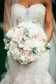 Ultra Elegant Bridal Bouquet Showcasing: White Peonies, White Roses, Light Blush Pink Roses, Dusty Miller
