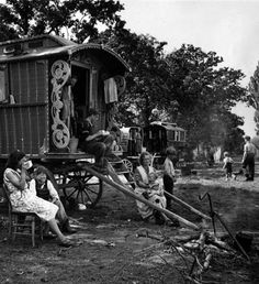 12th September 1942 A family of gypsies sitting outside their caravan on an encampment at Brook Farm during the fruit picking season