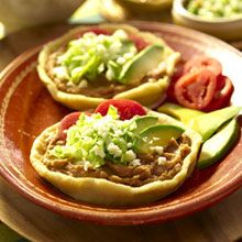 Sopes: Sopes are like tortillas, but thicker. Wonderful when topped with refried beans, lettuce, shredded cheese and tomatos. In some Mexican regions they are eaten with avocados. Enjoyed throughout the whole country, from Tijuana to Cancun.