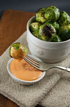 Roasted Brussels Sprouts with Sriracha Aioli... Swap the Mayo with Yogurt and this sounds like a fantastic healthy treat!
