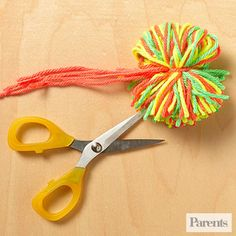 Kids will love winding colorful yarn to create these fluffy pom-poms.