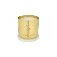 Tom Dixon candle: roses, cinnamon, and Chinese herbal market
