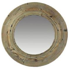"""Natural wood-framed wall mirror.   Product: Wall mirror    Construction Material: Wood and mirrored glass    Color: Light brown and gray     Dimensions: 32"""" Diameter"""