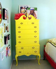 I LOVE the idea of painting a second hand dresser in a cool shape a bright color for a kid's room.