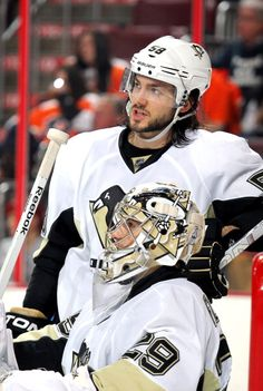Kris Letang goes down to talk to Marc Andre Fleury during all the scrums